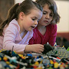 Wenham: From left, Lily Morrell, 6, and Emma Fuller, 7, both of Rockport, work on their Lego masterpiece at the Wenham Museums Lego Maniacs Palooza. Photo by Mark Lorenz/Salem News