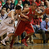 Danvers: Central Catholic's Jaycob Morales drives towards the basket as  St. Johns Prep Michael Carbone tries to put the pressure on in first half of play.  Photo by Mark Lorenz/Salem News
