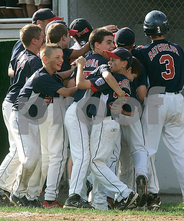 Bristol: Peabody West celebrates after a grand -slam by Matt Hosman in the bottom of the 6th inning, giving Peabody a 11-7 victory over Rhode Island in the New England Finals, giving them a trip to Williamsport. Photo by Mark Lorenz/Salem News