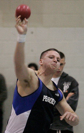 """Peabody: Peabody'sNick Marotta throws for 44' 8"""" during track meet against Beverly. Photo by Mark Lorenz/Salem News"""