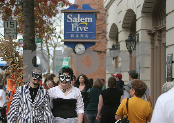 Salem: By Saturday afternoon, thousands of people were seen walking around Salem dressed in Halloween costume, as seen here along Washington Street. Photo by Mark Lorenz/Salem News