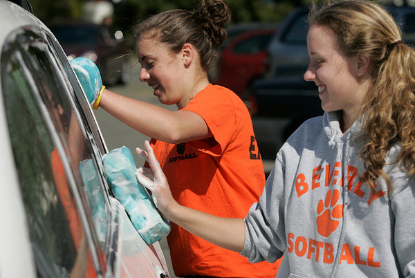 Beverly: Erin Silvestri and Rachel Willwerth wash a car during the Beverly High School softball teams annual car wash, held at the Memorial Building this past Saturday. Photo by Mark Lorenz/Salem News