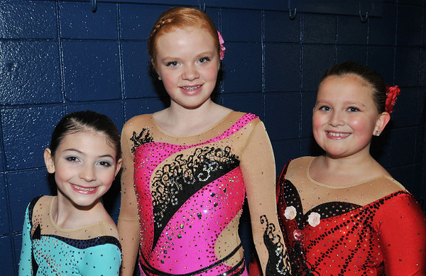 Peabody: Maddi McClung, 9, of Georgetown, Geneva Griffin, 11, of Middleton, and Johanna Geary, 11, of Danvers have qualified to compete this August at the figure skating State Games of America in San Diego, CA. photo by Mark Teiwes
