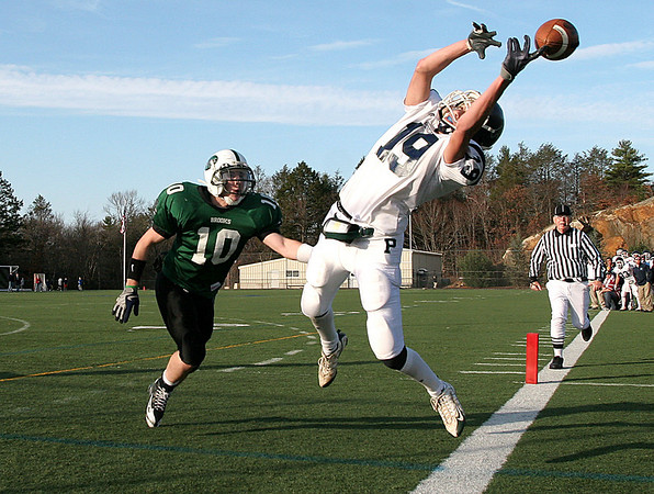 Beverly: Pingree School's Ehab Hamdan cannot grasp this pass in the first half of play, as Brooks School Brian Charlebois is right on him n the Clark/Francis Bowl as part of NEPSAC playoffs, played at Endicott College. Pingree defeated Brooks 7-6. Staff by/Mark Lorenz