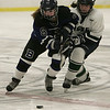Hamilton: Pingree's Kristina Caradonna and Berwick's Tilly Burzynski battle for the puck in EIL Hockey Finals. Pingree fell 5-4 in sudden death overtime. Photo by Mark Lorenz/Salem News