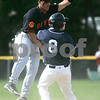 Beverly; St. John's Prep's Derek Dubois is safe at second on a bad throw, as Beverly's Peter Kallas tries to grab the throw. Photo by Mark Lorenz/Salem News