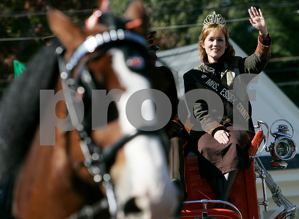 Topsfield: Karen Moniz, Mrs. Essex County greets while riding along with the Hallamore Clyesdale's around the Topsfield Fair.  Photo by Mark Lorenz/Salem News