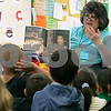 "Salem: Nathaniel Bowditch School ESL kindergarten teacher, Lucille Ouellette, reads, "" Flower Garden "", to her students. Ouellette won,""Teacher of the Year""  from the Massachusetts Assocation of Teachers of speakers of other languages. Photo by Mark Lorenz/Salem News"