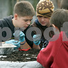 Peabody: Brandon DeBerardinis and Colin Brennan, look at what they found in this compost heap, while learning about what lives in them, at Brooksby Farms. Higgins Middle School students were at the farm learning about different things from Randy Weld of the Park and Rec Department. Photo by Mark Lorenz/Salem News