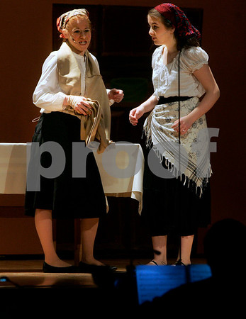 """Peabody: Elizabeth Green, left and Meaghan O'Brien rehearse for the upcoming production of, """"Fiddler on the Roof,"""" Thursday morning. Bishop Fenwick's production of the play will open Friday & Saturday at 7pm and Sunday at 2pm. Photo by Mark Lorenz/Salem News"""