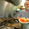 """Danvers: Kyriakos """" Kary """" Andrinopoulos prepareds a plate for a  customers during lunch time at his restaurant, New Brothers Restaurant & Deli. Photo by Mark Lorenz/Salem News"""