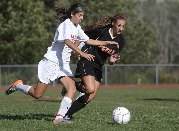 Topsfield: Masco's Gabby Russo heads down field as Ipswich's Lydia Early closes in, during first half of play. Photo by Mark Lorenz/Salem News