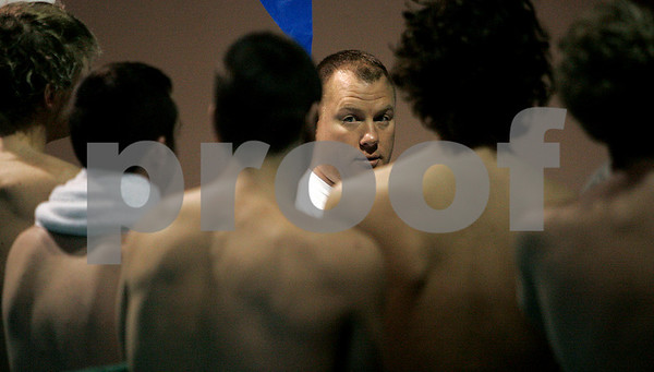 Danvers: Tony Padvaiskas head coach for St. John's Prep swim team , speaks to his swimmers prior to their Wednesdy morning practice at the Danvers YMCA. St. John's Prep are going for their fourth straight state swimming championship Friday night.Photo by Mark Lorenz/Salem News