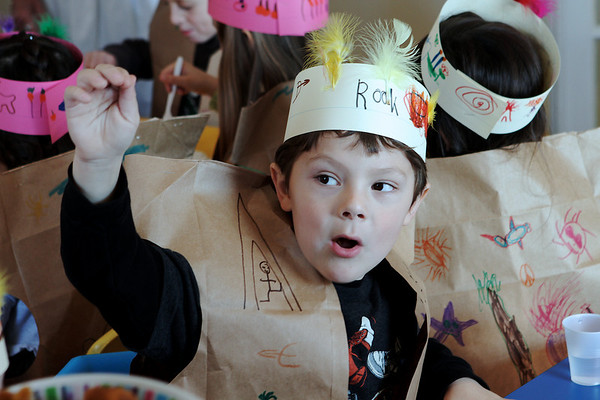 Beverly: Rook Landman, raises his hand fo rme food, during the Thanksgiving Feast at Mrs. Alexander's School in Beverly. Photo by Mark Lorenz/Salem News