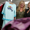 Salem: Mary Beth Tirrell, V.P. of apparel and Sarah McIlroy, CEO of Fashion Playtes, an online store where girls can design there own apparel. Photo by Mark Lorenz/Salem News