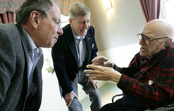 Swampscott: David Sherman, a long time Swampscott Rotarian, turns 100. A member of the rotary club for 75 years, speaks with long time friends, Bill DiMento, left and  Buck Weaver, treasurer for the club, during his birthday celebration, held at the Abbott House. Photo by Mark Lorenz/Salem News. Wednesday, March 14, 2007