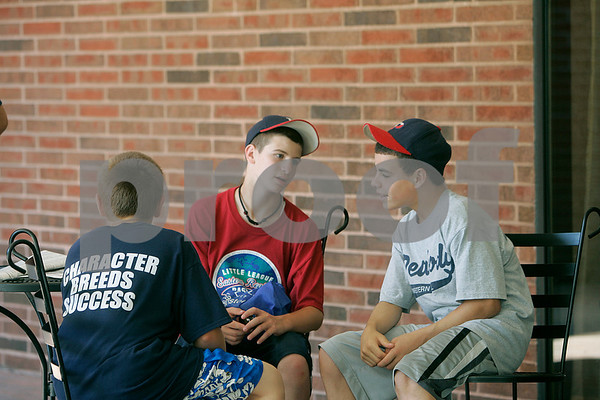 Bristol:Peabody West Little League players, Cody Wlasuk, Mayy Gonic and Nick Bona, relax with their families at the Marriott, during their day off, before playing today. Photo by Mark Lorenz/Salem News