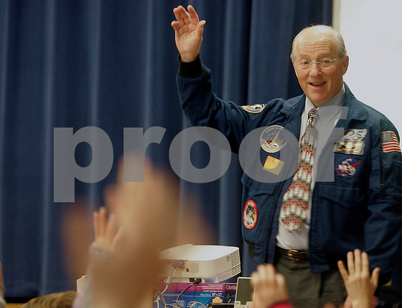 Hamilton: Captain Rick Hauck , U.S. Navy asks students questions before the start of his slideshow, during his visit to the Winthrop School. Hauck spoke about his missions in space. Photo by Mark Lorenz/Salem News