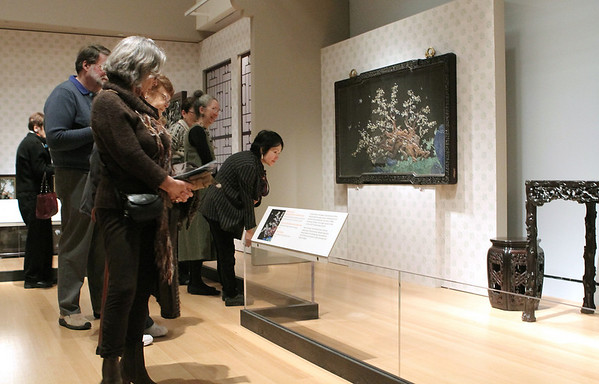 Salem: Viewers look over the exhibit, The Emperor's Private Paradise: Treasures from the Forbidden City<br /> which is on view till January 9, at Peabody Essex Musuem. Photo by Mark Lorenz/Salem News