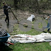 Danvers: Chris Manning and Mark Tomchik remove a large piece of metal from the woods at Cell Signaling Technology, the two men took part in Earth Day Clean Up, this is the first annual Earth Day Clean Up the company has sponsored.  About 20-25 employees were at hand along Trask Lane. Photo by Mark Lorenz/Salem News