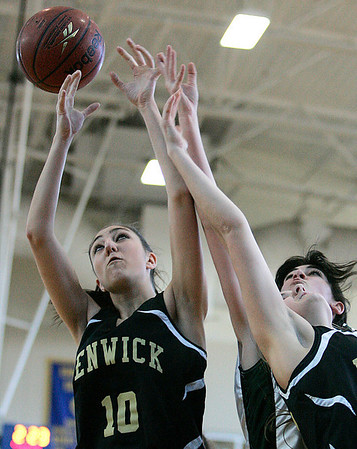 Boston: Bishop Fenwick Sarah James and Rebecca Graves block out a Pentucket High player for a rebound, during Division III North Sectional Championship at Emmanual College. Photo by Mark Lorenz/Salem News