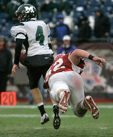 Foxboro: Masconomet defensive players, George Alexandrou tries to bring down Marshfield quarterback, Steve Sousa in the second half of play in Div IIA Superbowl against Marshfield, at Gillette Stadium. Photo by Mark Lorenz/Salem News