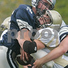 Hamilton: Hamilton-Wenham High's Jake Andre tackles Bishop Fenwick's Alex Crecco in the first quarter. Photo by Mark Lorenz/Salem News