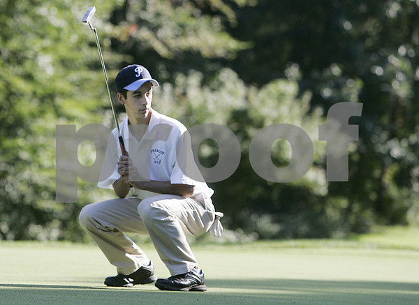 Salem: Peabody High School golfer, Sean Craven watches his putt during match against Marblehead High School at Salem Country Club. Photo by Mark Lorenz/Salem News Wednesday, September 24, 2008