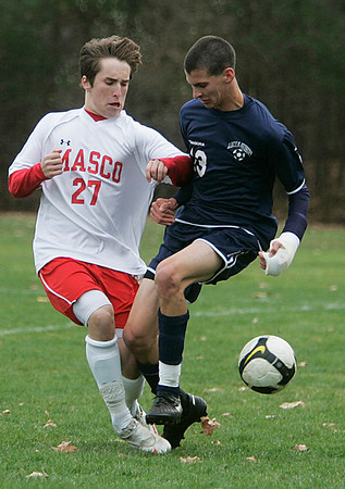 Topsfield: Masco's Charlie Behrens and Lincoln-Sudbury High Schools Daniel Birtwell avoid a collision while trying to get the ball, in Division 1 North quarterfinal. Staff by/Mark Lorenz