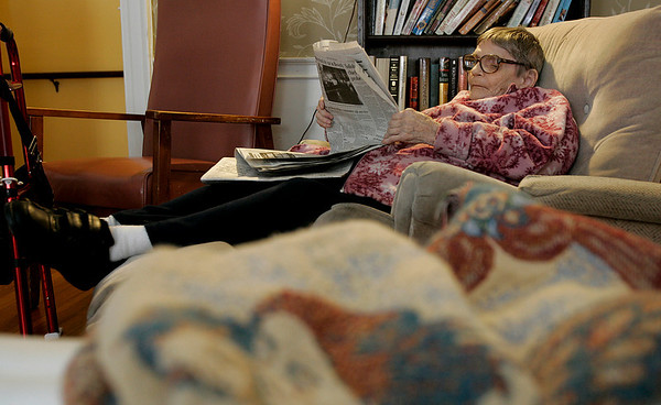 Salem: Helen Schaufler relaxes in the TV room at the Brookhouse Home, while reading the Salem News. The home will be celebrating its 150th birthday. Photo Mark Lorenz/Salem News