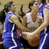 Peabody: Bishop Fenwicks Sarah James and Danvers Highs Janelle Saggese fight for this rebound in game at Bishop fenwick. Photo by Mark Lorenz/Salem News