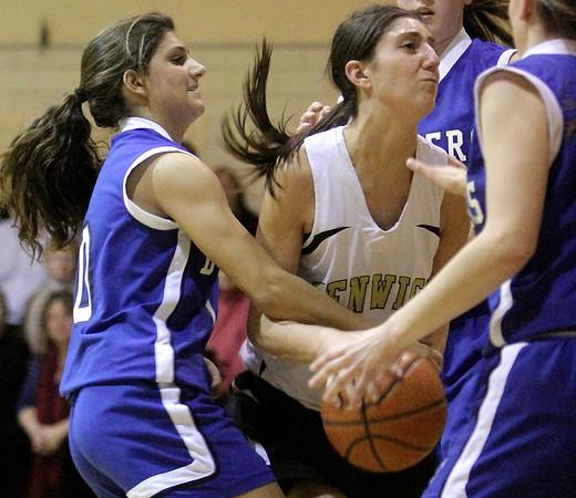 Peabody: Bishop Fenwicks Sarah James and Danvers Highs Janelle Saggese fight for this rebound in game at Bishop fenwick. Photo by Mark Lorenz/Salem News