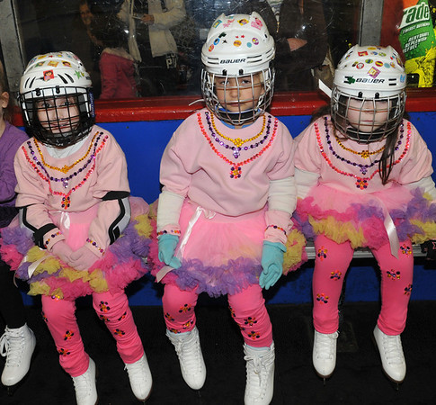 Peabody: Ava Visconti, 4, Allison Durand, 5, and Cece Lane,4, all from Peabody wait in the penalty box before their performance at the Peabody Skating Club's 36th annual Ice Show. photo by Mark Teiwes