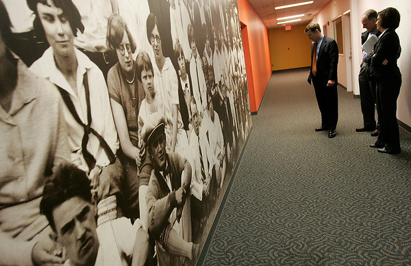 Beverly: Peter Richardson, Stephen Steinberg, and Tamie Thompson all of Jones Lang LaSalle, look over a mural of Parker Brothers employees at the former Artari building located at 50 Dunham Rd. Signature Office Park is redeveloping the building Photo by Mark Lorenz/Salem News