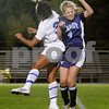 Danvers: Danvers High School's Tess Suanders head butts the ball against Peabody High's Amanda Nihan in the first period, at Danvers High School. Photo by Mark Lorenz/Salem News