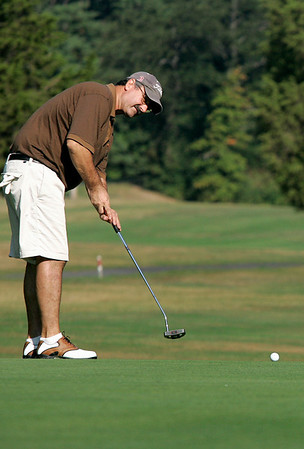 Boxford: Ron Harwood putts on the first hole, during the North Shore Amateur Golf Tournament, which took place at Far Corners Golf Course. Harwood is a memeber of Far Corners. Photo by Mark Lorenz/Salem News<br /> , Boxford: Ron Harwood putts on the first hole, during the North Shore Amateur Golf Tournament, which took place at Far Corners Golf Course. Harwood is a memeber of Far Corners. Photo by Mark Lorenz/Salem News