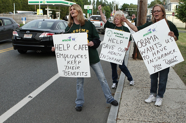Beverly: From Left, Cathy McGowan,  Mary Osbourne, and Michelle Larcom, managers who support workers, during a  protest outside of the Memorial Building, where the school committee is meeting. The protest is about them not wanting them to take away part-time workers health insurane benefits. Photo by Mark Lorenz/Salem News