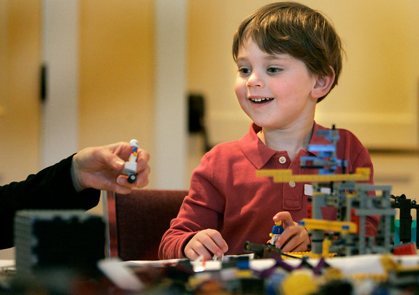 Wenham: Elijah Greenberg, 4, enjoys building Legos with his mother, Kim Dietel of Hamilton, during Wenham Museums Lego Maniacs Palooza. Photo by Mark Lorenz/Salem News