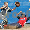 Bristol: Peabody West Traverse Briana doesn't get the throw in time to tag out Rhode Island's Samuel Brito, in the New England Finals. Peabody defeated Rhode Island 11-7. Photo by Mark Lorenz/Salem News