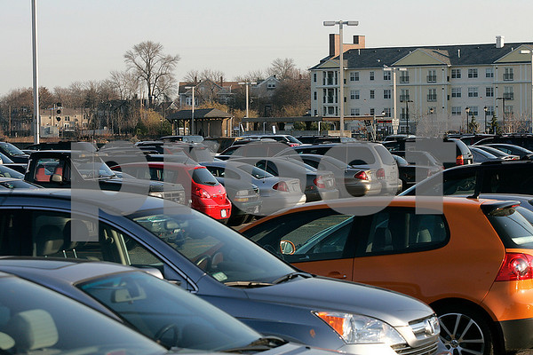 Salem: Commuters cars at the Salem train station early yesterday morning. The  Salem Partnership were at the station collecting signatures from train riders urging the state to build a new MBTA parking garage in Salem. Photo by Mark Lorenz/Salem News