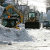 Salem: City workers remove snow on Essex Street, near Webb Street in preparation of more snow coming today and Wednesday. Photo by Mark Lorenz/Salem News