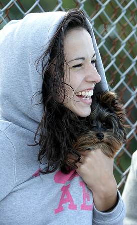 Peabody: Peabody High School junior Katie Henderson and her dog, Oscar at the Peabody high School boys soccer game against Beverly. Katie was there to cheer on captain Nick Melo. Photo by Mark Lorenz/Salem News