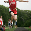 Hamilton: John Daniels in jump in meet against Hamilton-Wenham Regional High, in Hamilton. Photo by Mark Lorenz/Salem News