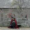 Salem: Beth Porior of Madison, Wisconsin, takes a break, as she enjoys the sights during Halloween in Salem. Photo by Mark Lorenz/Salem News