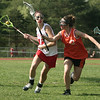 Middleton: Mascos Jane Sheridan looks down field to pass as Ipswich High Hannah Graham tries to block her in lacrosse game. Photo by Mark Lorenz/Salem News