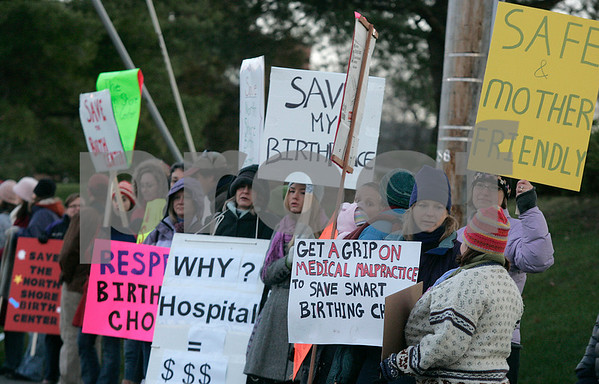 Beverly:  Mothers, expecting mothers, grandparents and others gathered along Herrick Street, in front of Beverly Hospital to rally, as trustees from Northeast Health System met to discuss a proposal to stop allowing births at the birth center. Photo by Mark Lorenz/Salem News