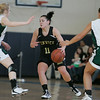 Boston: Pentucket High players Holly Jakobson and Sarah Higgins try to block Bishop Fenwick Amy Pelletier, during Division III North Sectional Championship at Emmanual College. Photo by Mark Lorenz/Salem News
