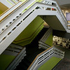 Beverly: The main stairwell inside of the former Artari buillding. At the bottom is an old mural of Parker Brother employees. Signature Office Park is redeveloping the building at 50 Dunham Rd. Photo by Mark Lorenz/Salem News