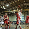 Danvers: St. John's Prep Stephen Haladyna goes up and over Central Catholic's Evan Sheehan in game. Central fell to the Prep 70-72 Photo by Mark Lorenz/Salem News