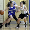 Peabody: Danvers High School basketball player, Kasey Sherry drives towards the basket as Bishop Fenwick's Amy Pelletier tries to defend her. Photo by Mark Lorenz/Salem News
